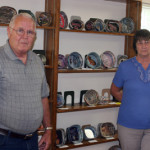 Joyce McDaniel and her husband with their display of bowls made from folded magazine pages.