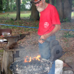 Meck Hartfield demonstrates his blacksmith skills.