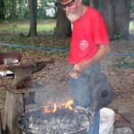 Meck Hartfield demonstrates his blacksmith skills.