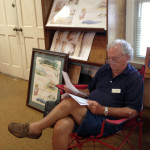 John Cribb with his watercolor prints.