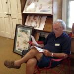 John Cribb with his watercolor prints.